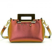 Load image into Gallery viewer, Front of small ruby iridescent vegan leather purse with black rectangular acrylic handles.  Purse is riveted together with dark silver rivets and gold hard wear.  Top snaps closed and has detachable strap to wear as crossbody or shoulder bag.  Has small loop of fabric on front upper right to hold purse charm.  Available for purchase at sadieanddaisy.com
