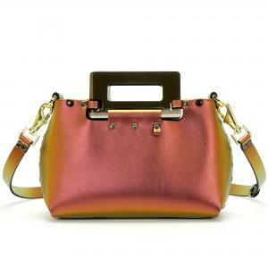 Front of small ruby iridescent vegan leather purse with black rectangular acrylic handles.  Purse is riveted together with dark silver rivets and gold hard wear.  Top snaps closed and has detachable strap to wear as crossbody or shoulder bag.  Has small loop of fabric on front upper right to hold purse charm.  Available for purchase at sadieanddaisy.com