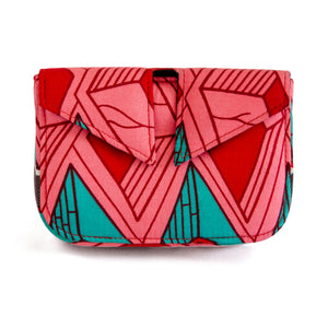 Front of small box bag with split flap front to be used as a clutch or shoulder bag.  Made with bright pink, red and teal Ankara fabric in Nigeria.