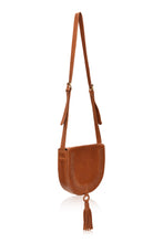 Load image into Gallery viewer, Structures crossbody saddle bag in tan leather with snap closer and hoop with tan leather tassel hanging off bottom.  Front has detail of woven leather in line just in from edge of front flap.