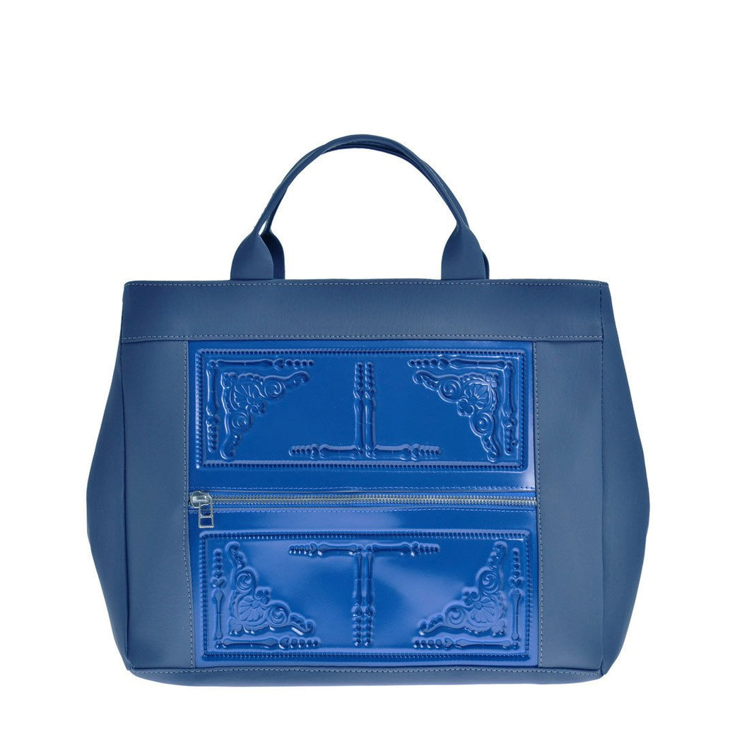 Asia crossbody front of work bag/tote in blue with embossed pattern and handles.  Has strap to carry as crossbody and fits computer.
