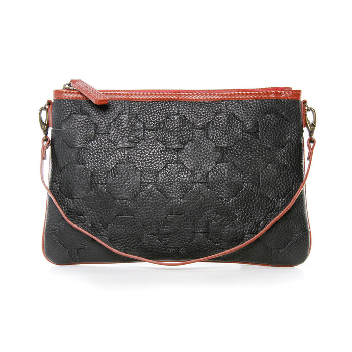 Front of clutch with small strap down.  Rescued black leather bag woven together with sides and straps made from reclaimed fire-hose.  Zipper top closure.  Come with detachable and adjustable strap that allows bag to be used as shoulder bag.  Can also be used as clutch or wristlet with small strap that is detachable.