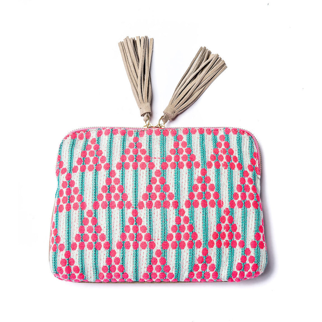 Front of Kavya Clutch Aqua.  This clutch is rectangular with a zip closer and two leather beige/off white tassels.  The clutch is made from woven cotton that is white with aqua stripes and has pink circle embroidery that makes a triangle pattern.  This bag supports girls education in India.
