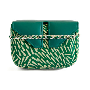Front ofSmall box bag clutch that has detachable chain to allow it to be worn as a shoulder bag.  Rectangular box made of Adire green fabric with tear drop like lighter green/white pattern.  Closure with split flap top that is made of green leather.