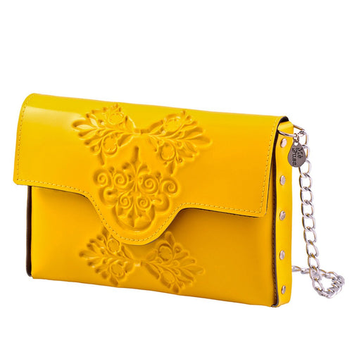 Small yellow clutch or crossbody.  Yellow plastic like material made from 90% recycled material with unique embossed pattern on body of bag and flap.  Edges of bag are riveted together with silver rivets.  Closure with magnet.  Has silver colored chain to be worn as crossbody or tucked in to be used as a clutch.
