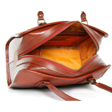 "Load image into Gallery viewer, Hand made red ""Post Bag"" purse/handbag made from reclaimed fire hose and parachute silk.  Two handles and zipper top with one interior zip pocket.  Comes with long adjustable and removable strap to carry as a crossbody.  Bag is durable and water resistant.  Shown from top showing bag open with orange inside parachute silk."