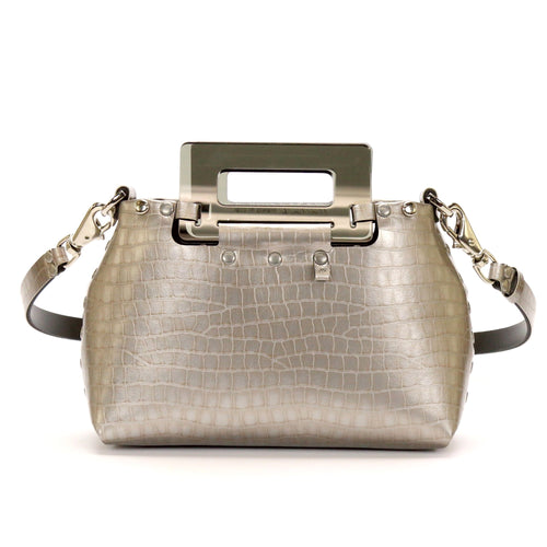 Front of small silver crocodile patterned vegan leather purse with smokey rectangular acrylic handles.  Purse is riveted together with silver rivets.  Top snaps closed and has detachable strap to wear as crossbody or shoulder bag.  Has small loop of fabric on front upper right to hold purse charm.