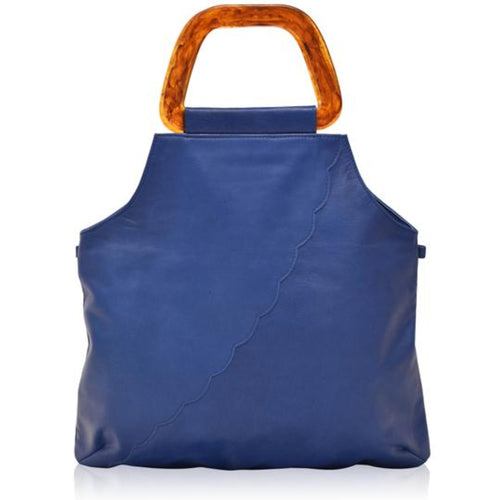 Surreal blue leather handbag with scalloped pattern across front at a diagonal and resin handles.  Bottom of bag is rectangular then bag comes up and cuts into the sides to top where handles are attached.