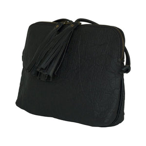 Tasman Piñatex black crossbody or clutch shown from side with two tassels on zipper pulls