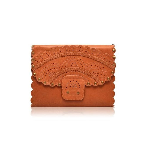 Front of Calypso tri fold wallet in vintage tan leather with scalloped edges and riveting.  Features intricate cut out pattern, flap front.