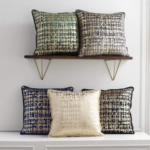 beige and black throw pillows