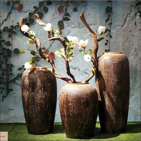 three brown luxury floor flower vases