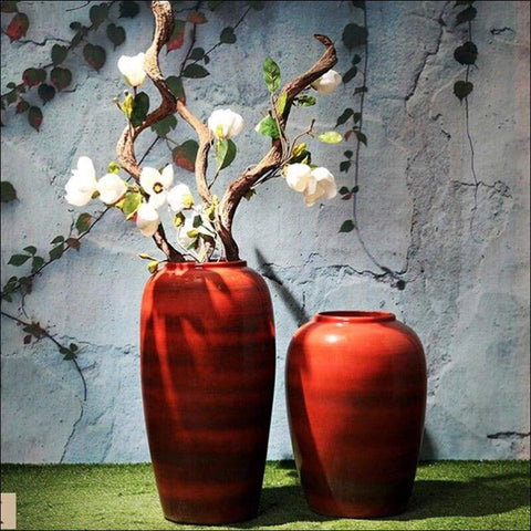 two red luxury floor flower vases