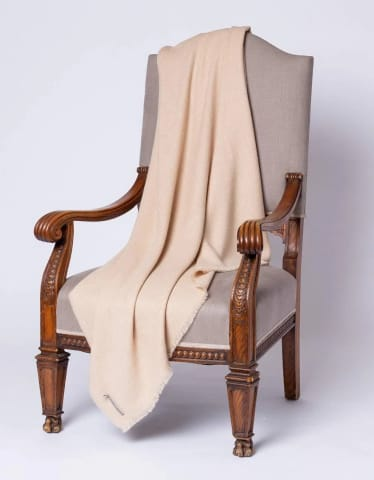 tan wool throw blanket on chair