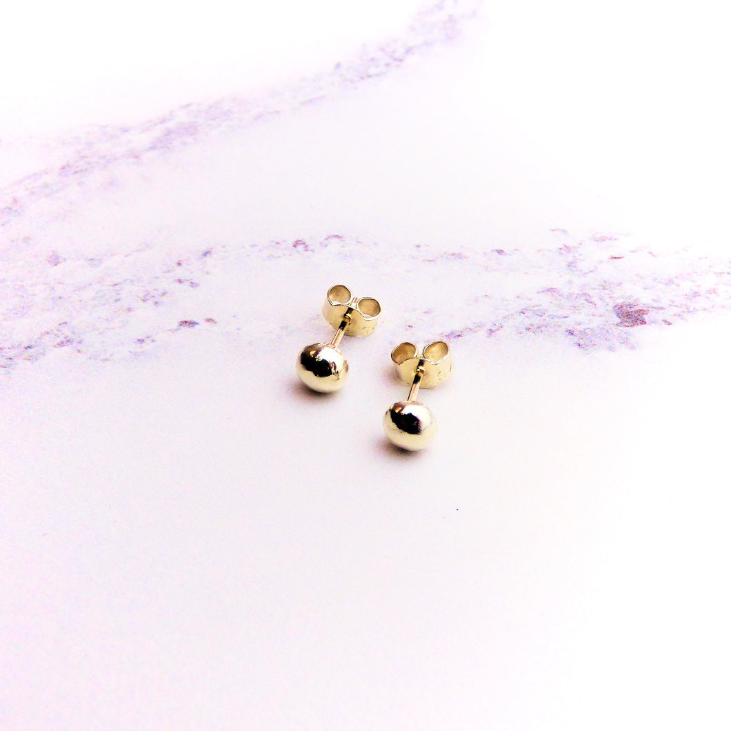 White gold recycled pebble studs
