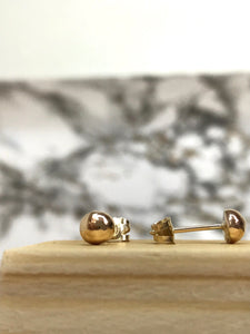 Yellow gold pebble stud earrings