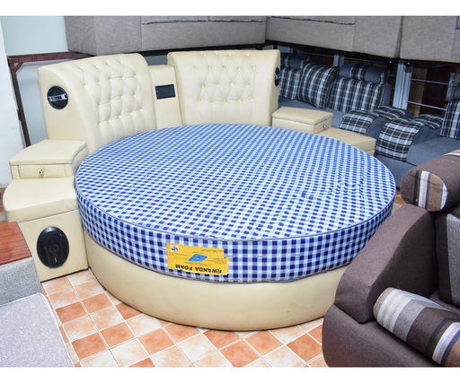 Circle bed with radio having 4 speakers on both side of bed and small TV  and using SD and flash and Rwandan foam mattress