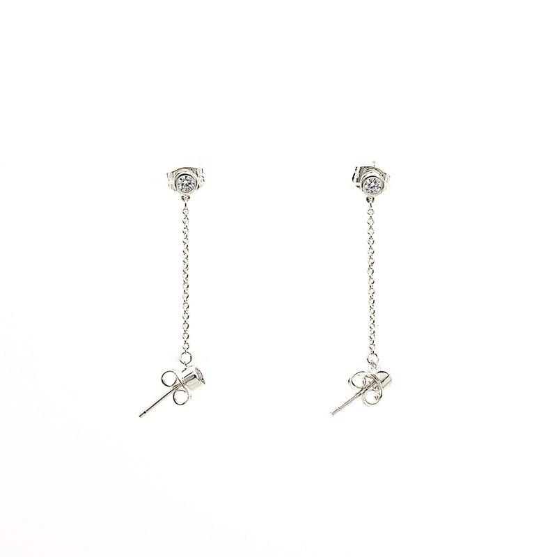 edgy and modern two stud cubic zirconia earring with chain