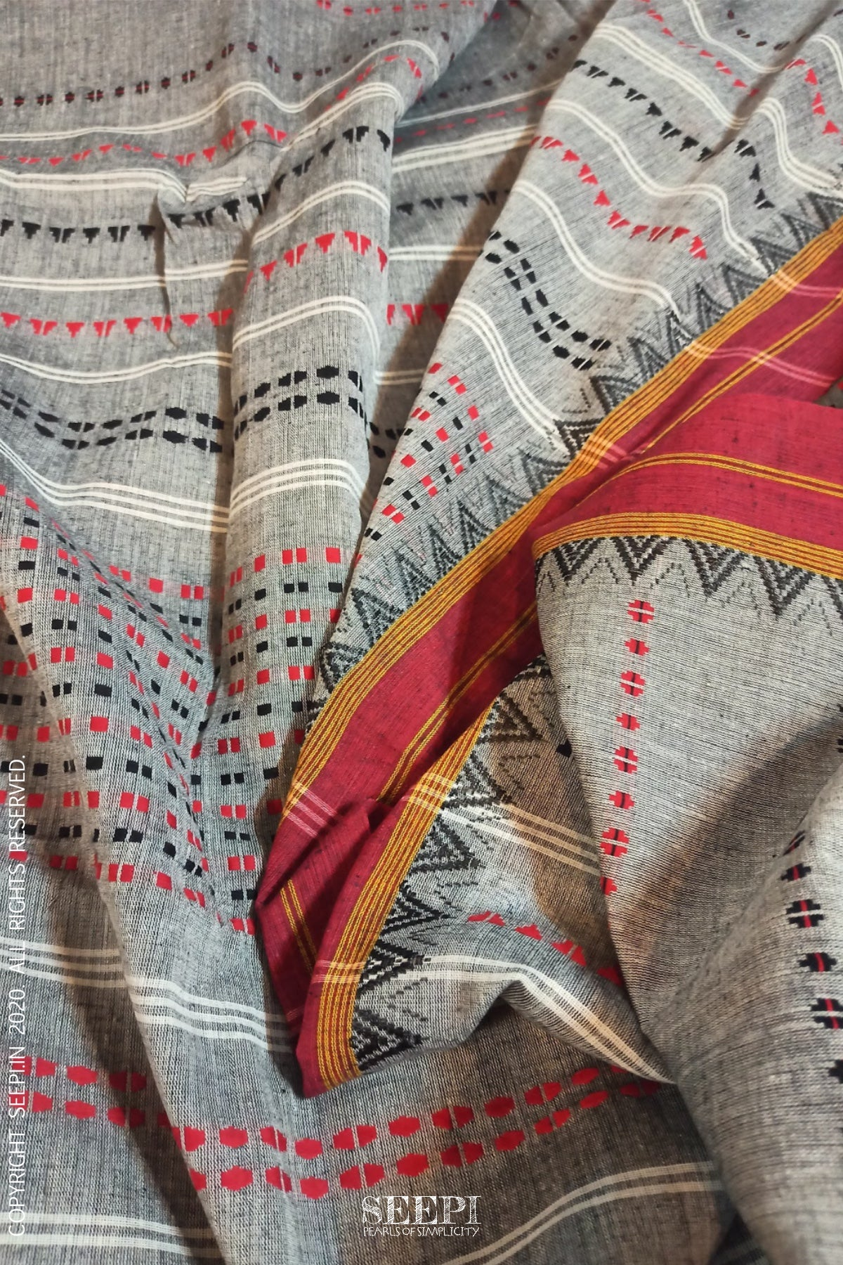 Uneven texture of a handloom saree