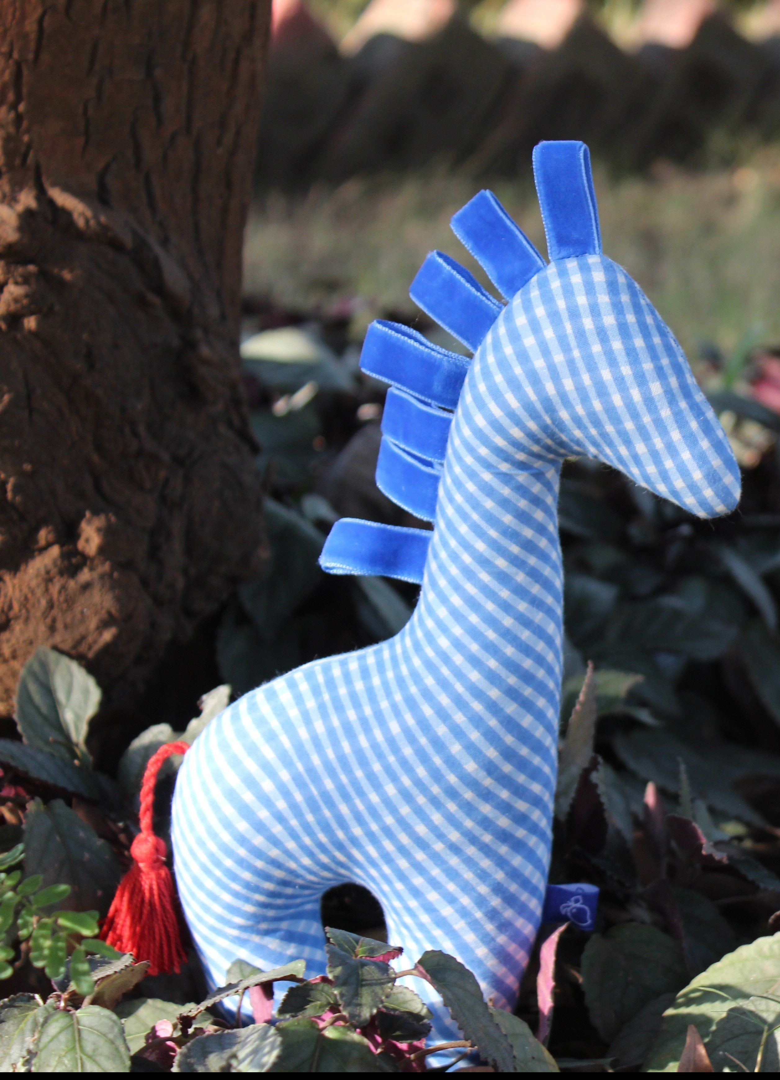 Blue colored handmade in India giraffe plush toy