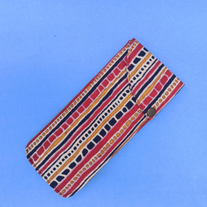 Yellow and red multipurpose block printed pouch from Bagru, Rajasthan.