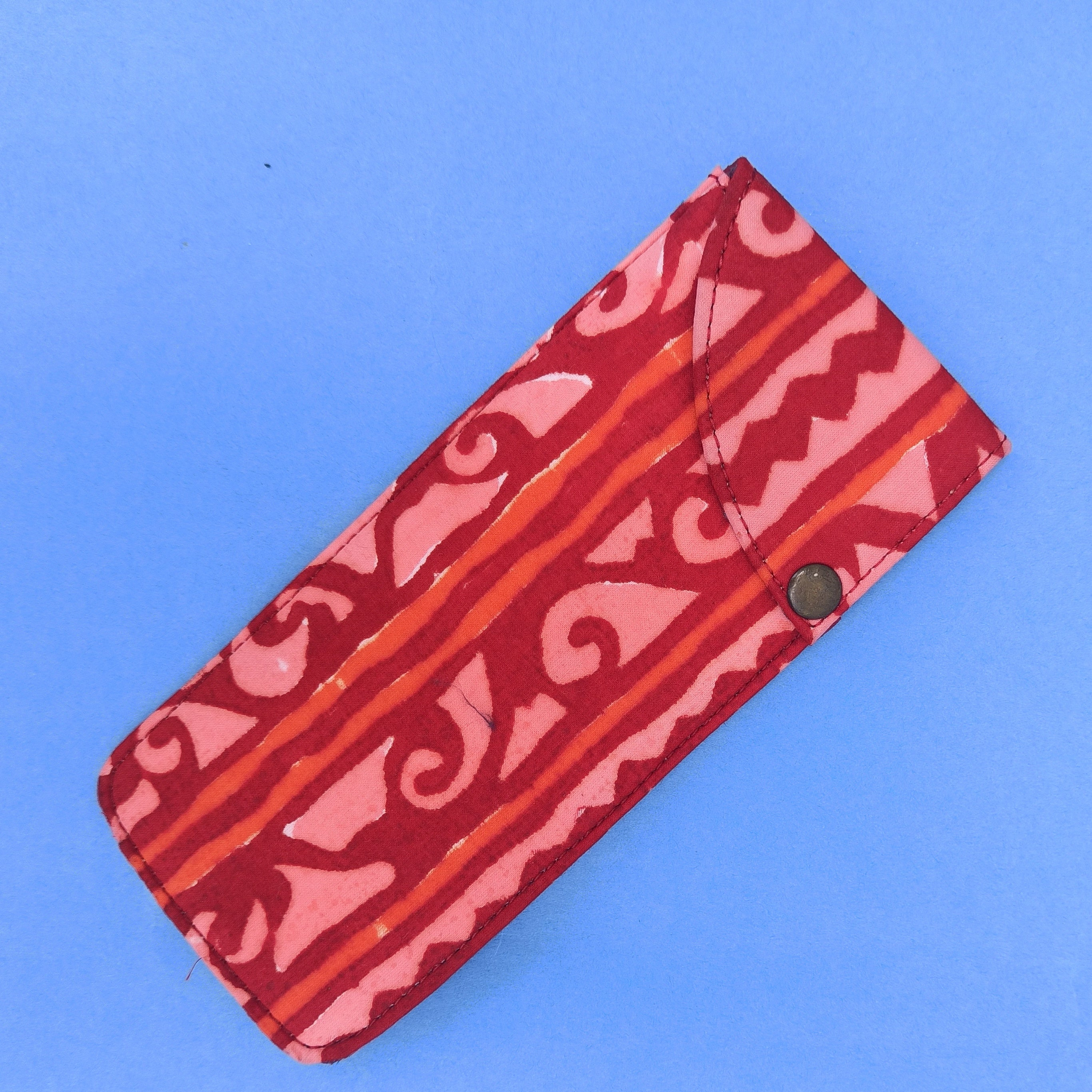 Red multipurpose block printed pouch from Bagru, Rajasthan.