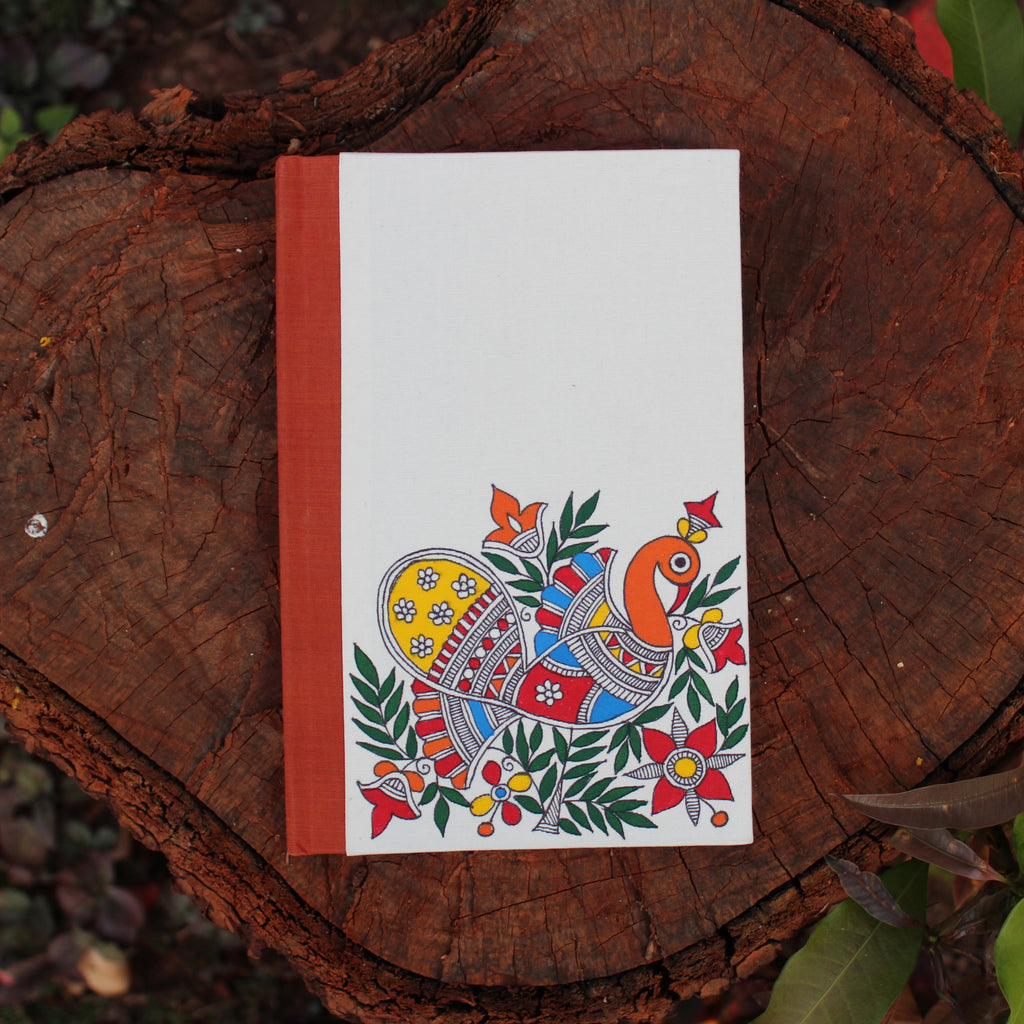 Handpainted notebook depicting Madhubani art. The peacock motif has been painted on the cover by a Madhubani artist from Bihar.