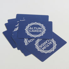 Altum Cards spread on surface.