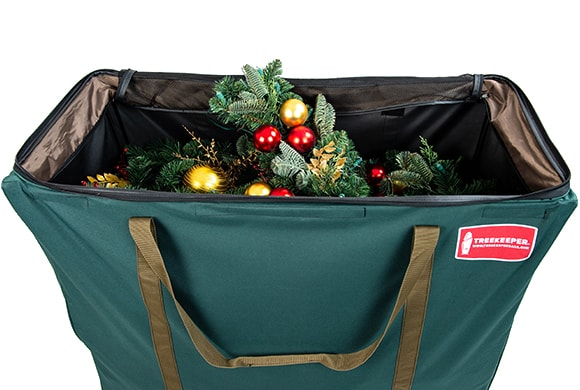 TreeKeeper Bags Big Wheel Multi-Use Storage Bag Full Of Christmas Wreaths And Garlands