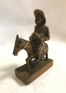 Hand Carved Man Riding Donkey