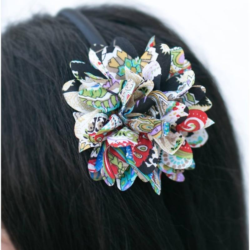 Wicked Wonders VIP Bling Headband With a Flower in Her Hair Multi-Colored Headband Affordable Bling_Bling Fashion Paparazzi