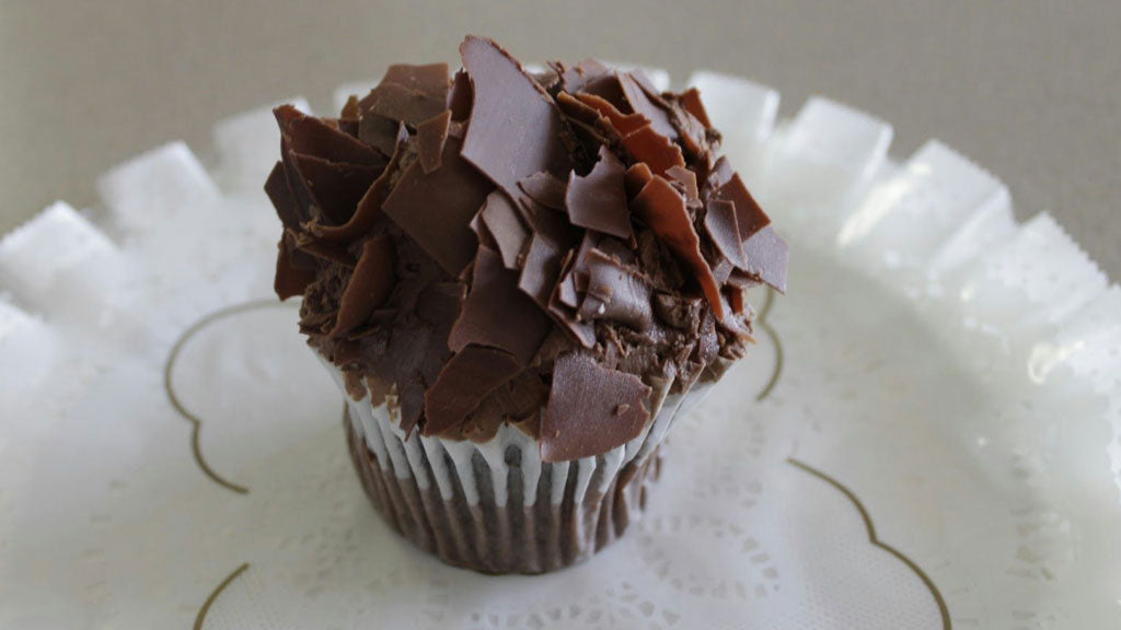 Chocolate cupcake with mousse and chocolate shavings
