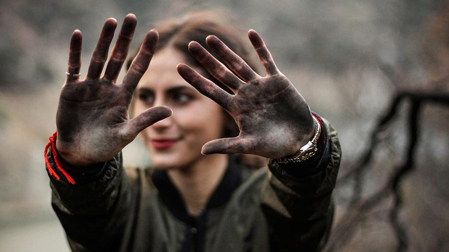 dirty jewelry on muddy womens hands