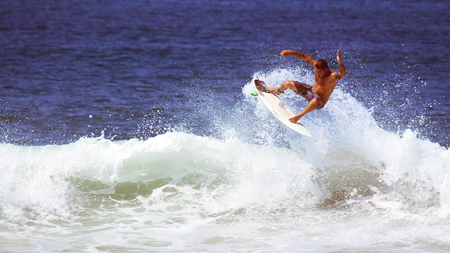 Ocean Jobs, Surf Instructor riding breaking wave