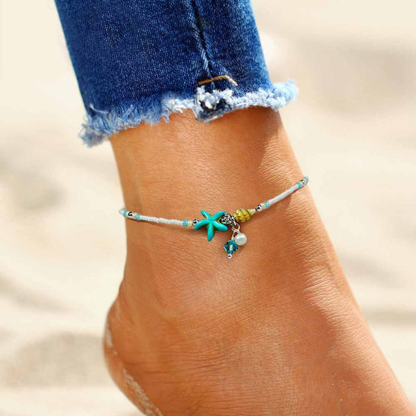 Woman wearing a Turquoise Starfish Anklet with Shell Charms