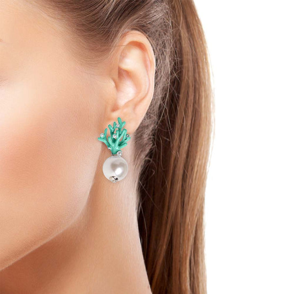 Green coral earrings on model