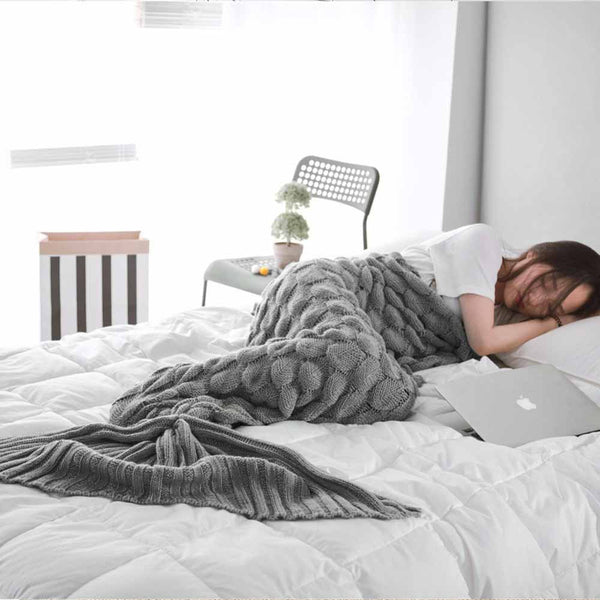 Woman sleeping inside of a Grey Knitted Mermaid Blanket
