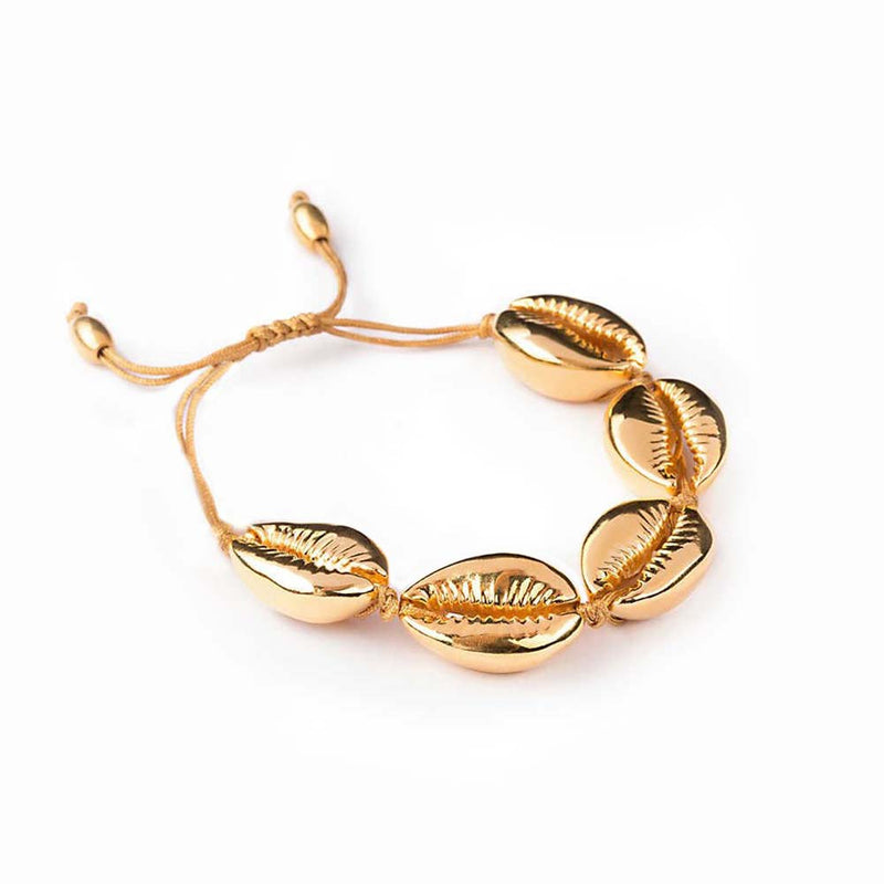 Gold seashell bracelet on cord