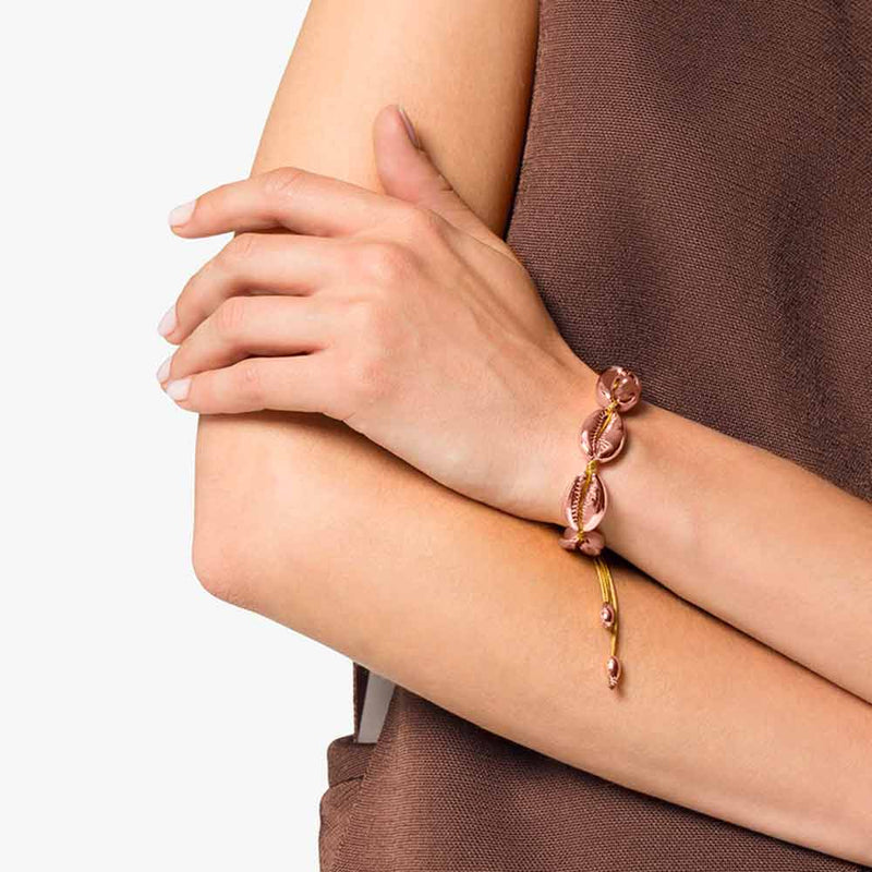 Rose Gold Cowrie Bracelet on woman's wrist