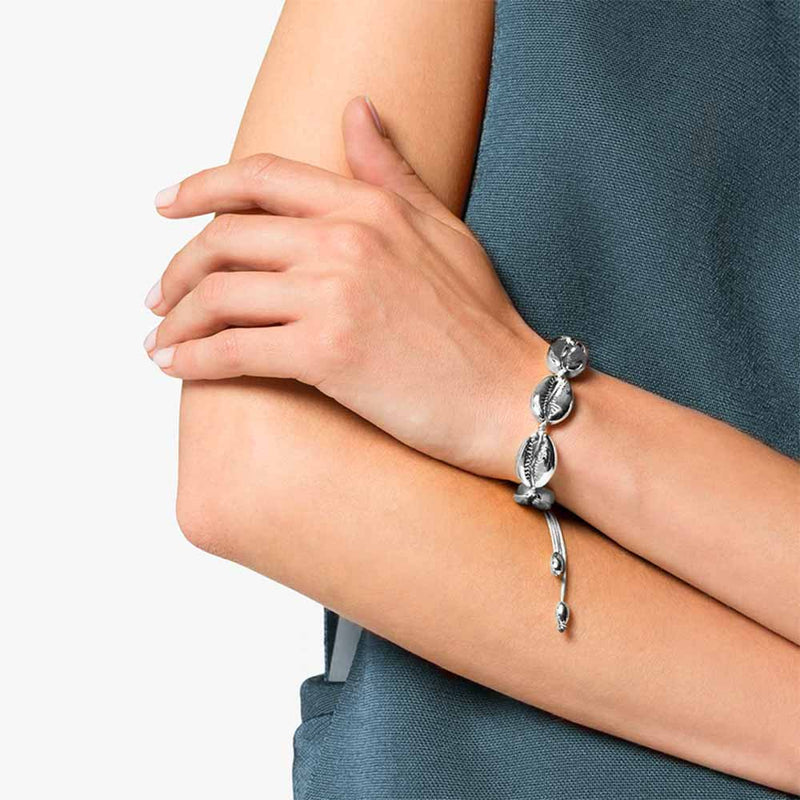 Woman wearing Silver Cowrie Shell Bracelet with Grey Cord