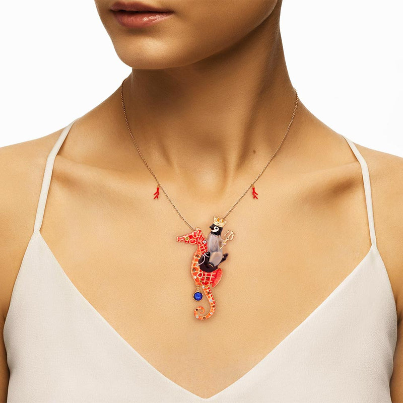 Woman wearing statement Seahorse Necklace with Penguin