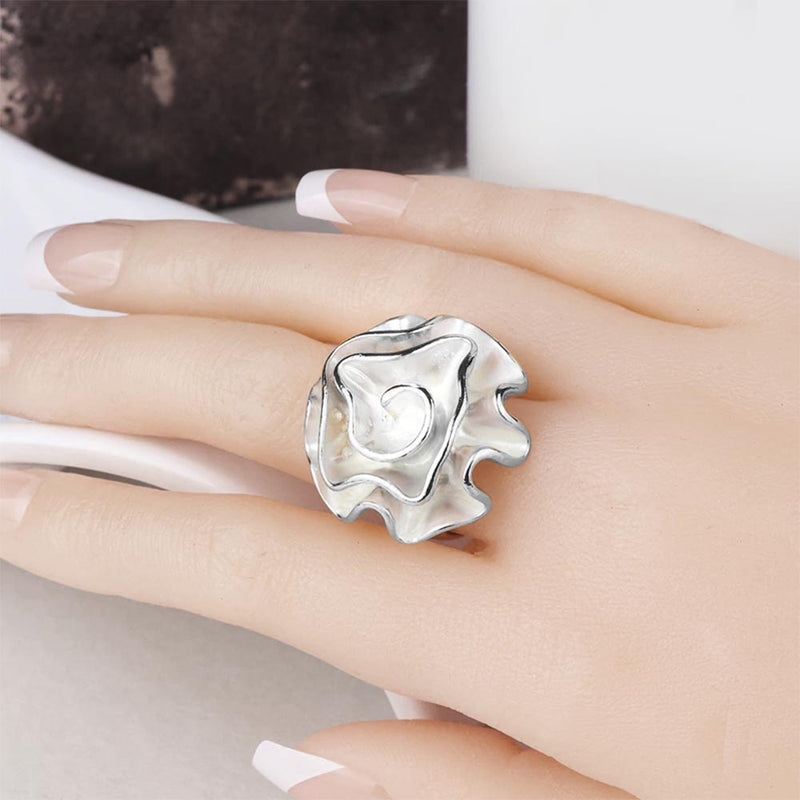 Silver Fox Coral Ring on women's middle finger