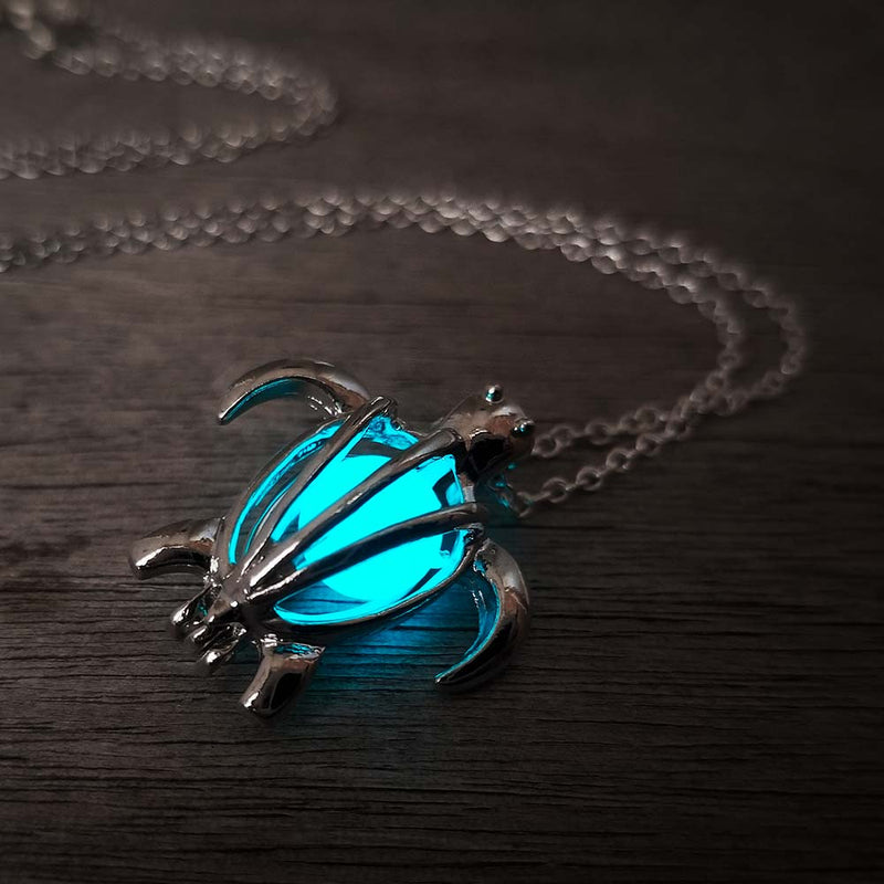 Glowing cyan silver turtle pendant