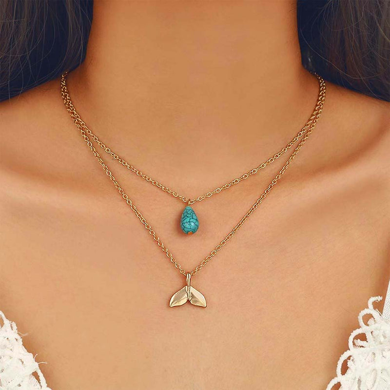Model wearing a double chain necklace with Turquoise Charm and Mermaid tail Pendant