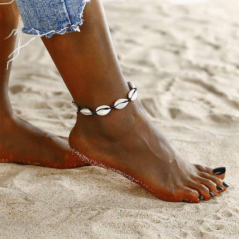 Woman wearing Natural Cowrie Shell Anklet