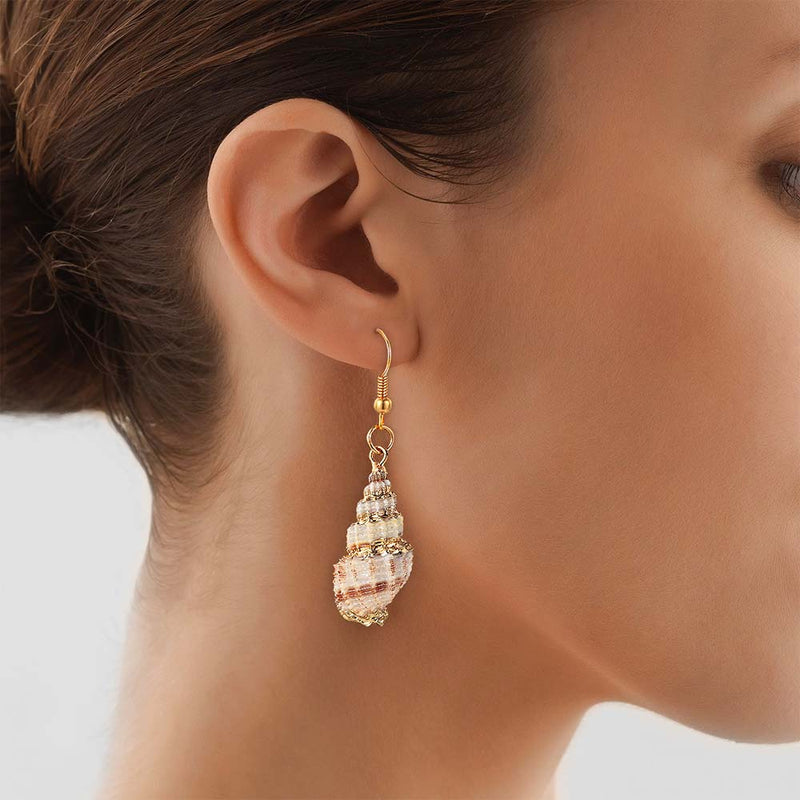 Woman wearing Shell Earring with Gold Detail