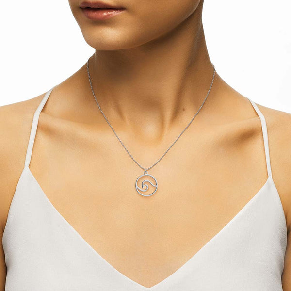 Silver wave necklace on women's neck