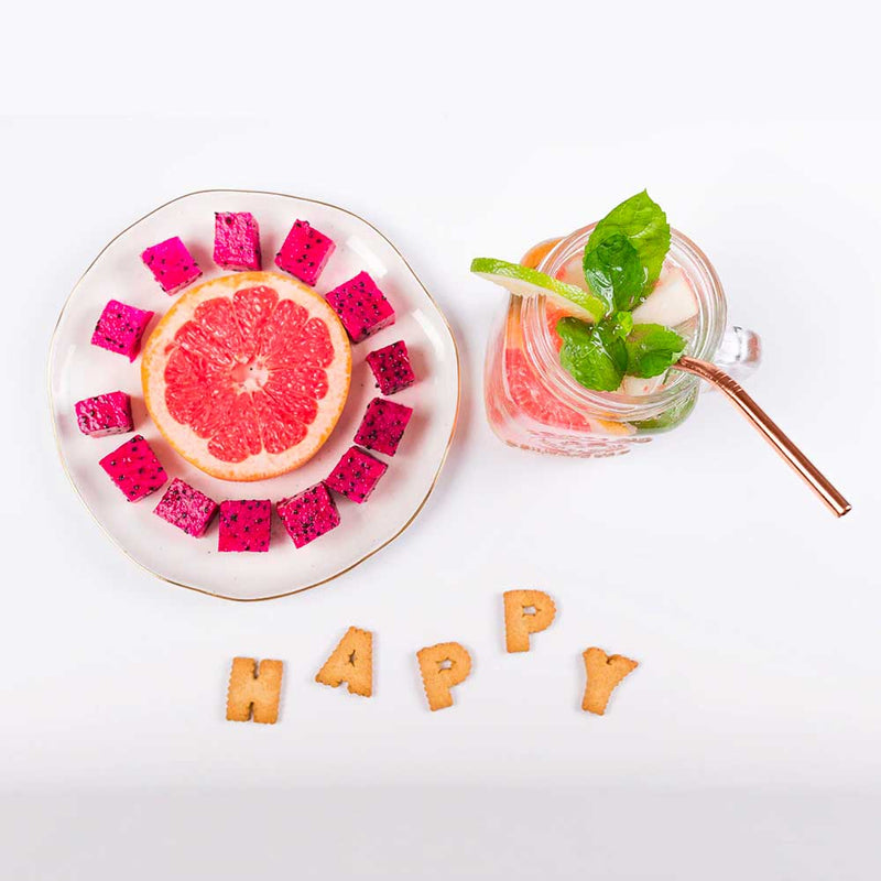 Happy fruit smoothie with metal straw
