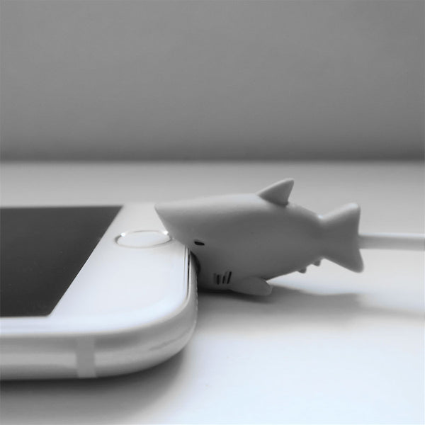 Shark Bite Cable Protector on white iPhone