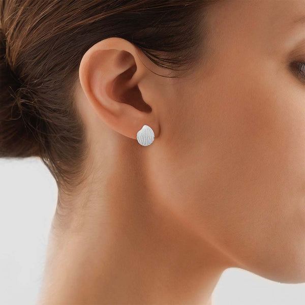 Model Wearing Clam Stud Earrings in Silver